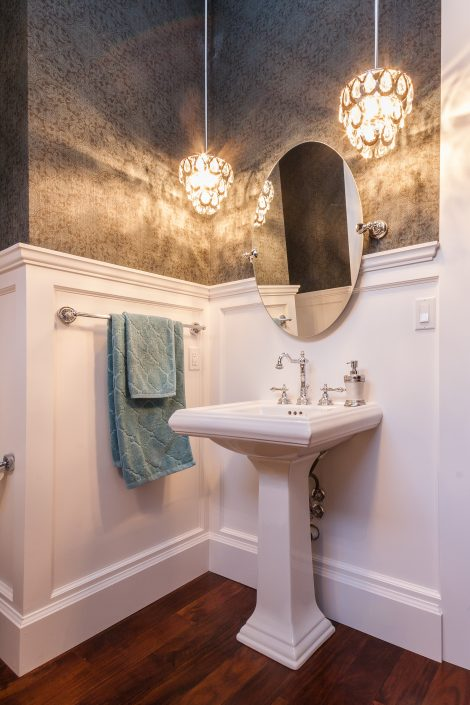 Rayn Properties   Transit custom powder room with unique wallpaper and mirror