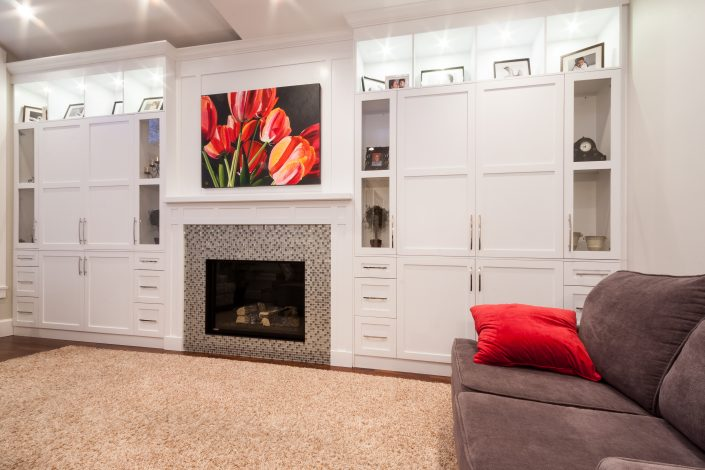 Rayn Properties | Transit Living space with custom fireplace and cabinetry